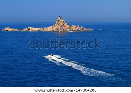Nautical sports on Adriatic sea near Sveta Nedelja island and church, Petrovac, Montenegro - stock photo