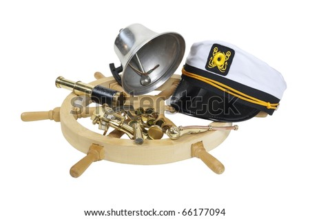 Nautical supplies including ship wheel, captain hat, bell, and an assortment of brass instruments - path included - stock photo