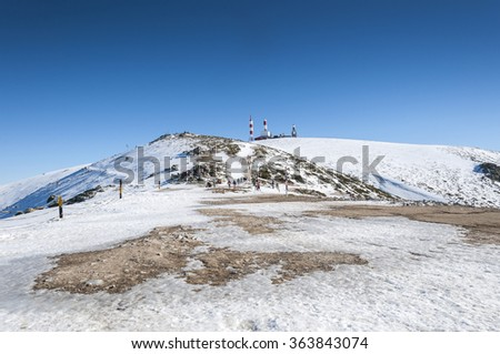 NAVACERRADA - JANUARY 4, 2015: Tourists in Navacerrada Ski Resort, Navacerrada Mountain Pass, Madrid, Spain, on January 4, 2015. - stock photo