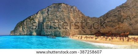 NAVAGGIO BAY/ZAKINTHOS ISLAND, GREECE - CIRCA JUNE 2015: Tourists flocking in famous Wreckship Pirate's Bay