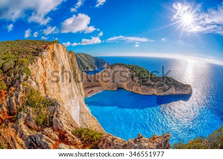 Navagio beach with shipwreck against sunset on Zakynthos island in Greece