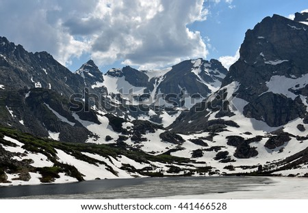 navajo and apache peaks as seen from lake isabelle in the indian peaks wilderness area, colorado - stock photo