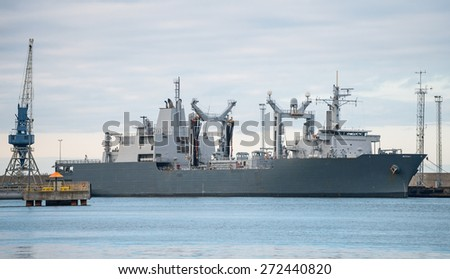 Naval auxiliary ship in the port. - stock photo