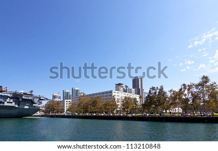 Naval ship and buildings in San Diego Harbor on sunny summer day