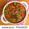Navarin of lamb, French lamb stew slow-cooked on the bone. - stock photo