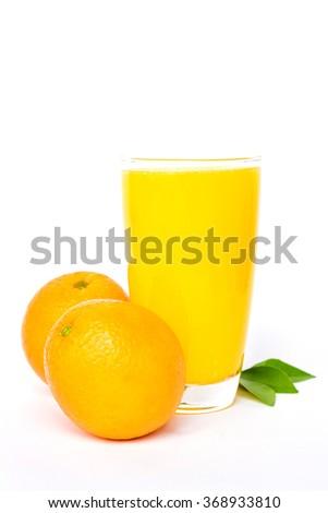 Navel orange juice with leaves isolated on white background - stock photo