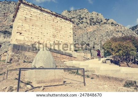 Navel to the world at the Temple of Apollo, Delphi, Greece - stock photo
