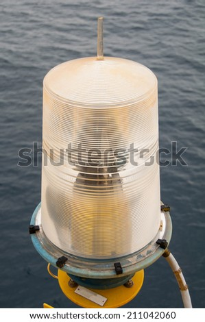 Navigation aid on the platform in offshore, Signal in marine, Light to show subject in the sea on night. - stock photo