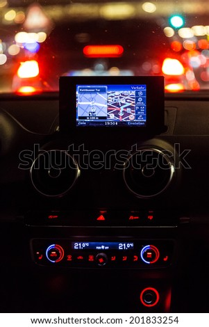 Navigation device in a car at night - stock photo