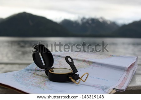 Navigation over sea with compass and map at Chile Fjords  - stock photo