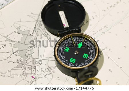 Navigational tools and compass on a nautical navigation map