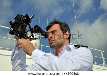 navigator with sextant on the watch on sea going vessel