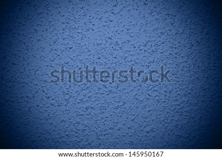 Navy blue grained wall background or texture