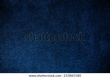 Navy glossy leather texture abstract, iridescent material dark blue toned, rough surface background in horizontal orientation, nobody. - stock photo