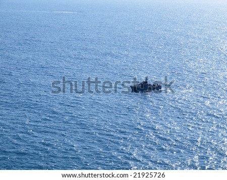 Navy patrol boat in action with blue ocean background