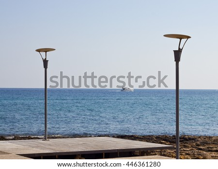 Navy pier with lanterns, sea view background