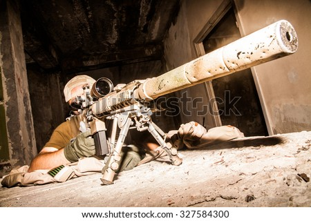 Navy Seal Sniper with rifle in action  - stock photo