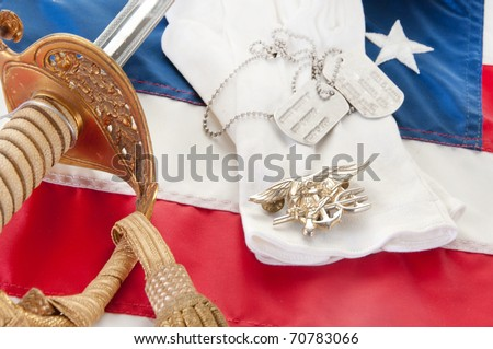 Navy SEAL trident and uniform items on flag - stock photo