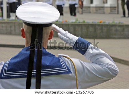 Navy soldier salutes at the lithuanian national flag ceremony - stock photo