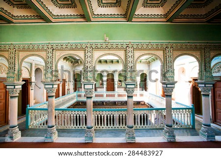 NAWALGARH, INDIA - FEB 6: Columns inside the colorful historical mansion of rich indian family on February 6 2015 in Rajasthan. With pop. of 100,000, Nawalgarh is education center of Shekhawati region