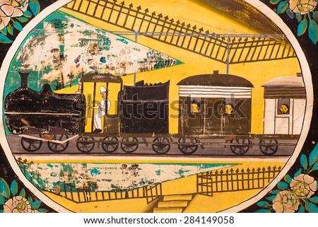 NAWALGARH, INDIA - FEB 6: Historical locomotive of the steam train on a fresco of old Haveli mansion on February 6, 2015. With popul. of 100,000, Nawalgarh is education center of Shekhawati region - stock photo