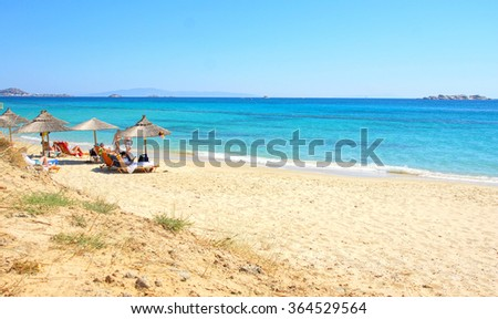 NAXOS - GREECE ; people at the beach at the Island of Naxos on 8 june 2015. Naxos is the largest Island of the Cyclades  - stock photo