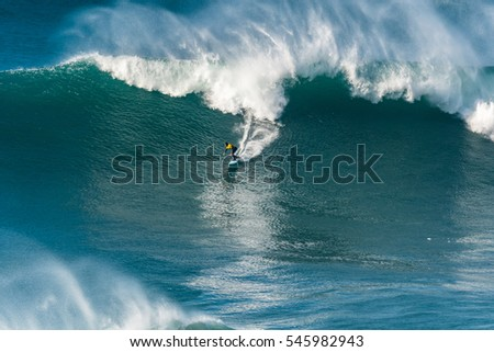 NAZARE, PORTUGAL - DECEMBER 20, 2016: Grant Baker (ZAF) during the Nazare Challenge 2016 - Big Wave Tour #3 at Praia do Norte - Nazare, Portugal.