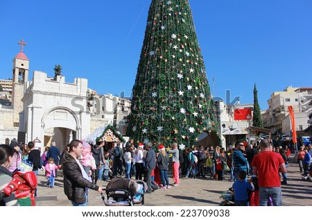 NAZARETH, ISRAEL - DECEMBER 21: People celebrate the Christmas, near the Greek Orthodox Church of the Annunciation in Nazareth, Israel, december 21, 2013 - stock photo