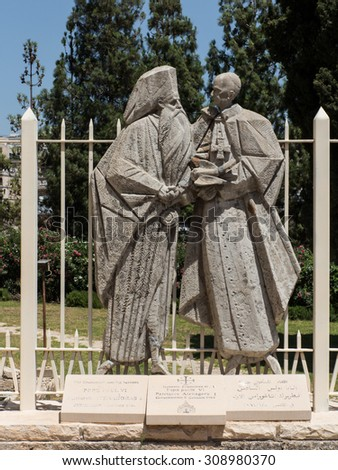 NAZARETH, ISRAEL-July 08, 2015: statue of Pope Paul VI and Patriarch Atenogoras I that is next to the Basilica of the Annunciation in Nazareth, Israel - stock photo