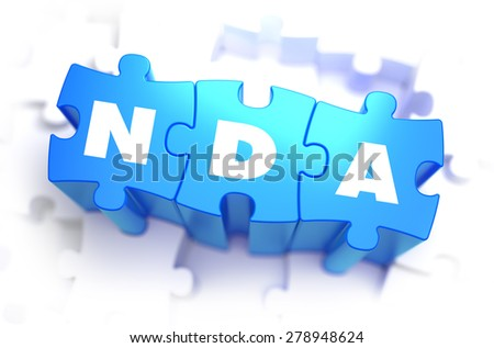 NDA - Non Disclosure Agreement - Text on Blue Puzzles on White Background. 3D Render.  - stock photo