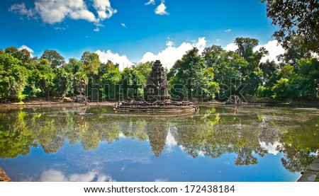 """Neak Pean (""""The entwined serpents"""") is an artificial island with a Buddhist temple on a circular island in Preah Khan Baray built during the reign of King Jayavarman VII. Angkor. Siem Reap. Cambodia. - stock photo"""