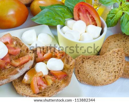 neapolitan food dried bread with olive oil and tomato and mozzarella - stock photo