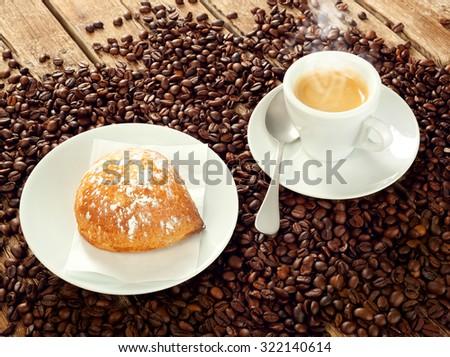 Neapolitan Sfogliatella frolla with cup of espresso coffee - stock photo