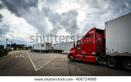 NEAR AUSTIN, TX/USA - NOVEMBER 5, 2015: Red truck maneuvering on parking lot