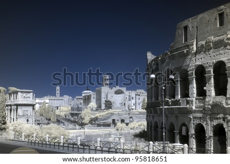 Near infrared, false colour, long exposure photo of Colosseum (coliseum), Arch of Constantine and Roman Forum, Rome, Italy. Moving tourists look a bit like ghosts. - stock photo