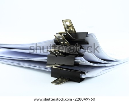 neat and tidy paperwork in black paper clips closeup