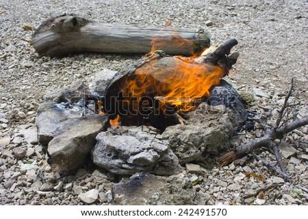 Neat little fire in the rocky soil. - stock photo