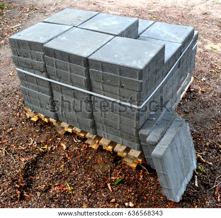 Neat stack of concrete blocks and bricks for sidewalk or streets