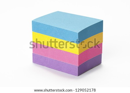 Neat stack of sticky notes in different colors. - stock photo