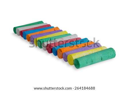Neatly aligned diagonal row of colored chalks in the colors of the spectrum or rainbow ready for little children to pick up on a white background with copy space - stock photo