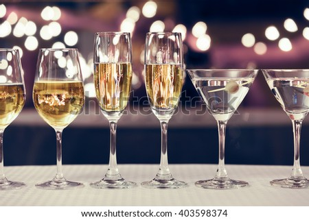 Neatly arranged alcohol drinks on a bar counter.  - stock photo