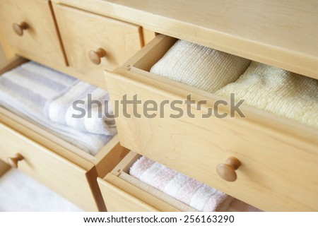 Neatly arranged clothing in drawers - stock photo
