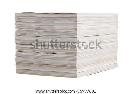 Neatly folded stack of magazines on white background - stock photo