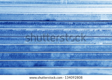 Neatly stacked rectangular tube - stock photo