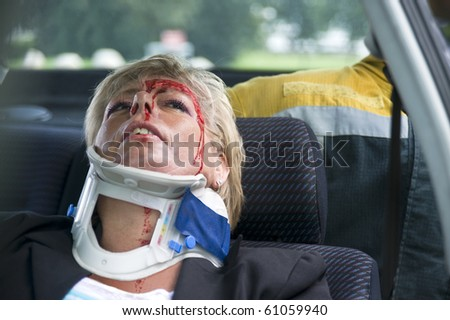 neck brace around a woman's neck to support her spinal cord after a severe car accident - stock photo
