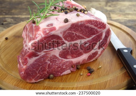 neck with rosemary and basil on chopping board - stock photo