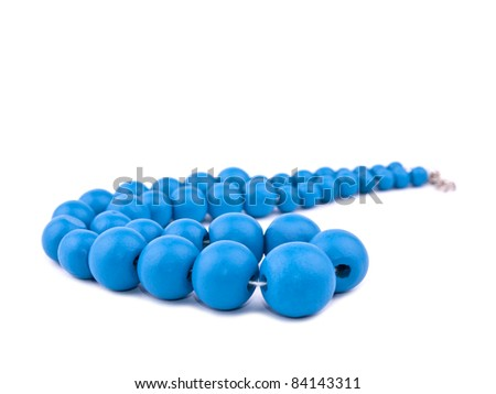 Necklace made from blue wooden beads on white background