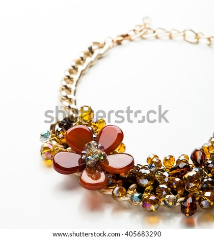necklace made of beads and stones isolated - stock photo