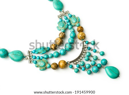 necklace of turquoise and jasper isolated on white - stock photo
