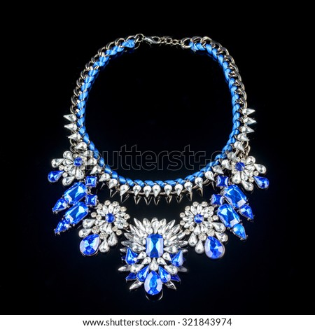 necklace on a black background in close up - stock photo